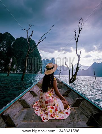 Woman In Longtail Boat At The Khao Sok Lake Thailand, Woman In Boat At The Cheow Larn Lake Thailand
