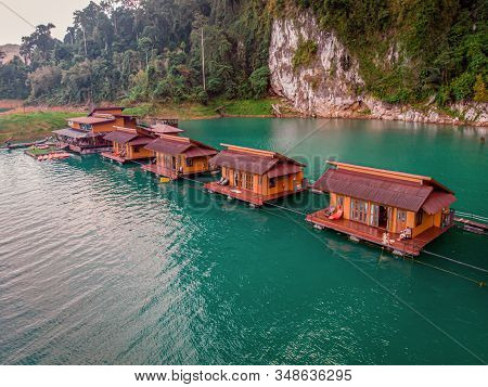 Floating Bungalows At Khao Sok Thailand, Drone View At The Lake With Couple In Front Of Bungalow
