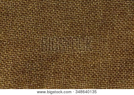 The Picture Shows A Brown Glittery Background