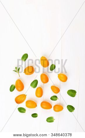 Fresh Kumquat  Fruits With  Mint  Leafs.kumquat  Pattern Background.vertical With Cpoy Space.