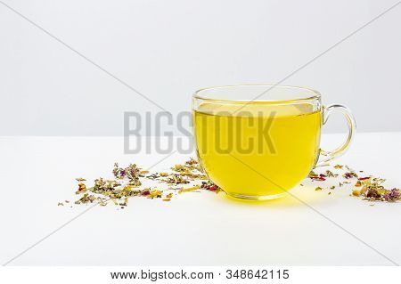 One Glass Mug Of Green Tea With Heap Of Dry Tea Leaves On A White Background, With Copy Space For Te