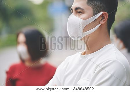 Serious Young Man Wearing Protective Face Mask When Walking Outdoors During Outbreak Of Coronavirus