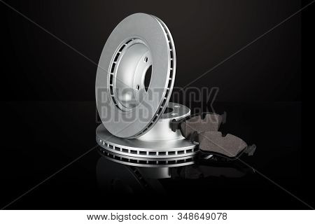 Car Or Automotive Brake Disc On Black Background With Reflection And Copy Space Around Products