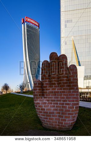 Milan, Italy - January 31, 2020: Hand Art Sculpture At Citylife Shopping District. Oversized Brick H