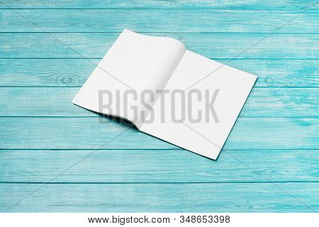 Mock-up Magazine, Newspaper Or Catalog On Blue, Wooden Background. Blank Page Or Notepad On Planks B