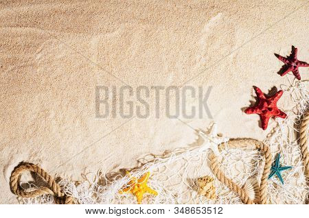 Summer Background With Copy Space. Top View Of Sandy Beach With Visible Sand Texture And Exotic Acce