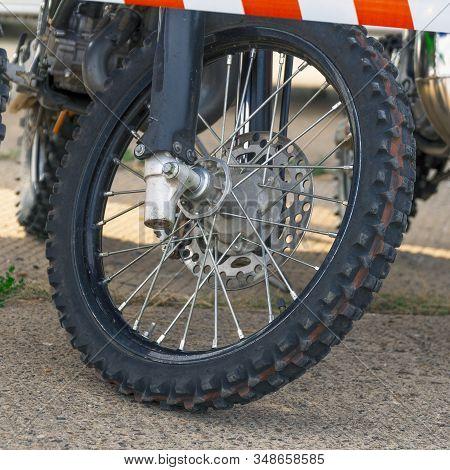 Front Wheel Motocross Bike Enduro On A Natural Background