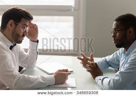 Recruiter Listens Applicant With Mistrust During Job Interview