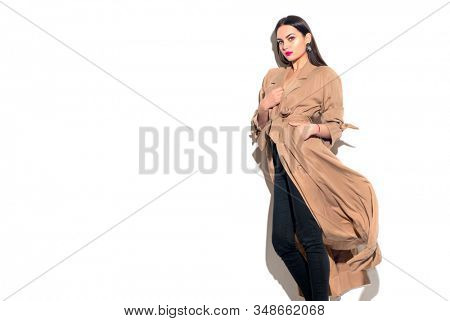 Beauty model girl posing in fashionable spring clothes, wear, apparel.  Beautiful young brunette woman in trendy outfit, fashion make up and accessories isolated on white background Urban street style