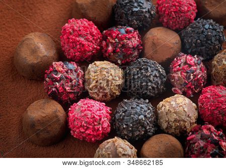Truffle Chocolates. Assorted Chocolate praline Candies. Chocolate Set Sweets. Round Candy Design Background. Heart Shaped Chocolate. Top view, flatlay backdrop