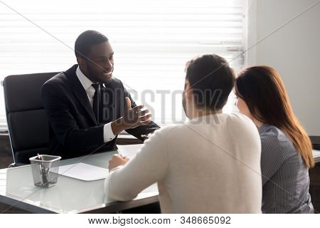 Rear View Couple During Meeting With Family Lawyer Consultant Indoors
