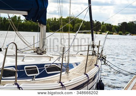 A Mooring With A Mooring Line Tied Around It With Boats And Ships In The Background In A Harbour Moo