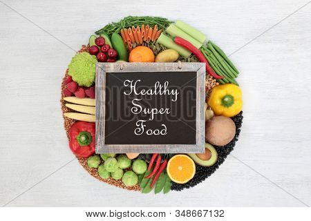 Healthy super food for vegans concept high in protein, vitamins, minerals, anthocyanins, antioxidants, smart carbs & dietary fibre with low cholesterol with blackboard & title & copy space.