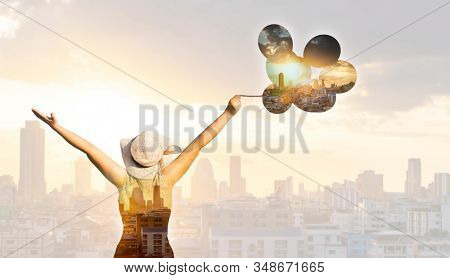 Double exposure photo of a young woman symbol of freedom combined with modern city skyline. Freedom, business concept.