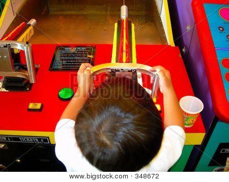 Boy Playing Arcade Game