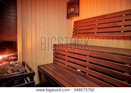 Steam Room With Wooden Shelves And Nice Lighting
