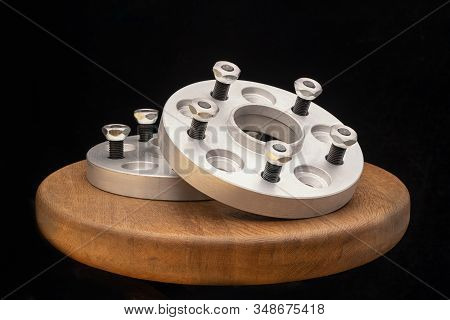 Automotive Parts - Close Up New Stainless Metal Remote Adapter Spacer Wheel Hub Of The Car. On Black