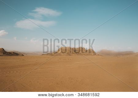 Sand Dunes In Wadi Ram In The Morning, Jordan.pink Sand In The Desert. The Mountains Are Located In