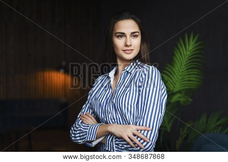 Attractive Young Girl Looking At The Camera. Model Posing In Front Of Camera During Photo Shot. Girl