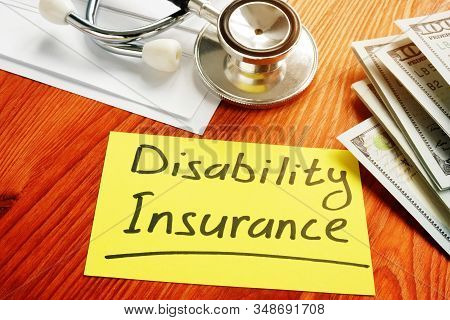 Disability Insurance Memo Sign With Money And Stethoscope.