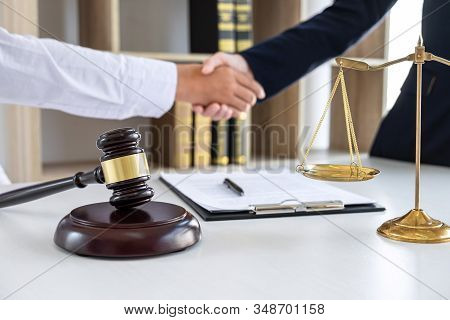 Handshake After Good Deal Negotiation Cooperation, Professional Female Lawyer Or Counselor And Clien
