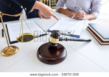 Professional Female Lawyer Discussing Negotiation Legal Case With Client Meeting With Document Conta