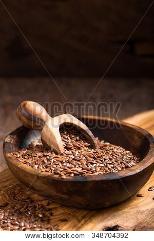 Flax Seeds Or Line  In Bowl  On Wooden Background. Flax Oil And Seeds