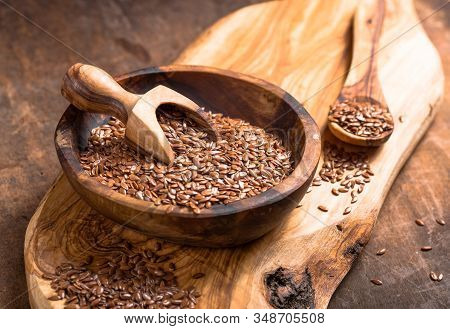 Flax Seeds Or Line  In Bowl  On Wooden Background. Flax Seeds