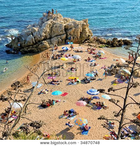 SANT POL DE MAR, SPAIN - AUGUST 17: La Roca Grossa Beach on August 17, 2011 in Sant Pol, Spain. The Catalan coast, where is Sant Pol de Mar, is the destination of millions of tourists in the summer