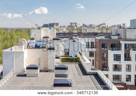Flat Roof With Air Conditioners On Top Modern Apartment House Building Exterior Mixed-use Urban Mult