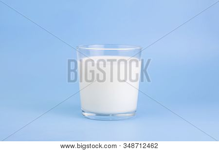 Fresh Farm Milk, Fermented Milk Product, In A Glass Cup, On A Holoumny Background. Selective Focus.