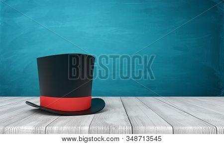 3d Rendering Of Black Tophat With Red Ribbon Standing On Wooden Table Near Blue Wall With Copy Space