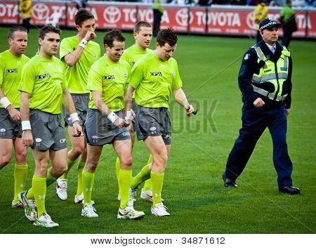 MELBOURNE - JUNE 30 : Umpires leave the ground after Collingwood's win over Fremantle on June 30, 2012 in Melbourne, Australia.