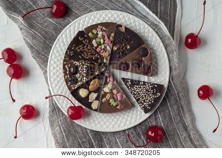 Delicious Chocolate Pizza And Cherries On White Table, Flat Lay Composition. Tasty Confection With D