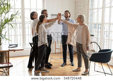Motivated Colleagues Give High Five Engaged In Teambuilding
