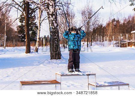 Boy On Skis On The Podium
