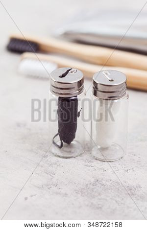 Close Up Of Two Bottles With Dental Floss