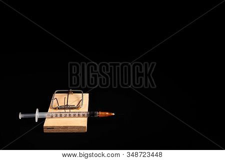 Mousetrap With A Bait In The Form Of A Syringe. Stock Photo Concept Of Addiction / Diabetes.