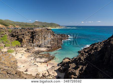 Waikiki, Hi - 23 January 2020: Tourists Swim In Halona Beach Cove Near The Blowhole In Oahu, Hawaii