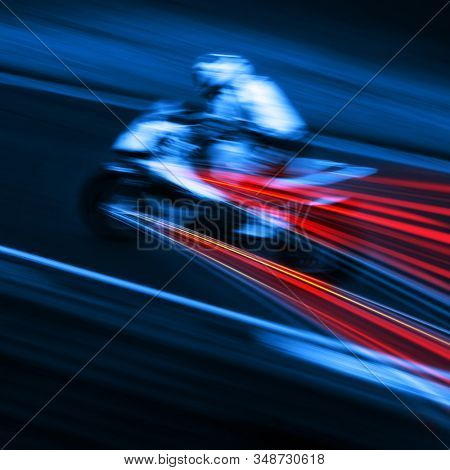 speeding motorcycle blur in blue and red