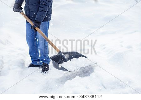 City Service Cleaning Snow Winter With Shovel After Snowstorm Yard Sunlight