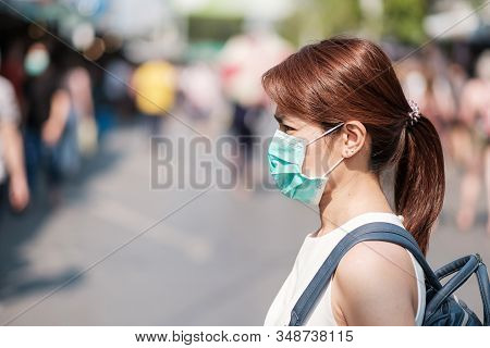 Young Asian Woman Wearing Protection Mask Against Novel Coronavirus (2019-ncov) Or Wuhan Coronavirus