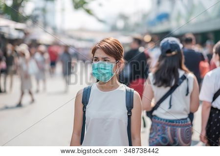 Young Asian Woman Wearing Protection Mask Against Novel Coronavirus (2019-ncov) Or Wuhan Coronavirus