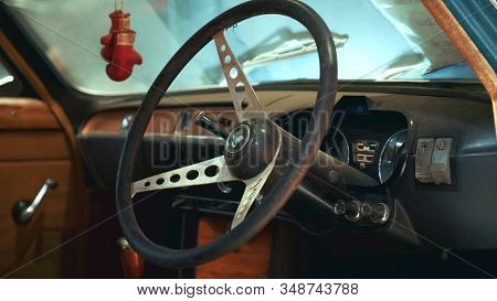 Close-up Shot Of Old Car Triumph Steering Wheel. Vintage Or Retro Transport. Warsaw, Poland - July 1