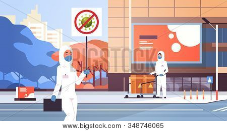 Scientists In Hazmat Suits Holding Stop Coronavirus Banner Disinfecting Epidemic Mers-cov Virus Empt
