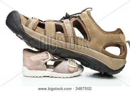 Male shoes stepping on small ones isolated over white poster