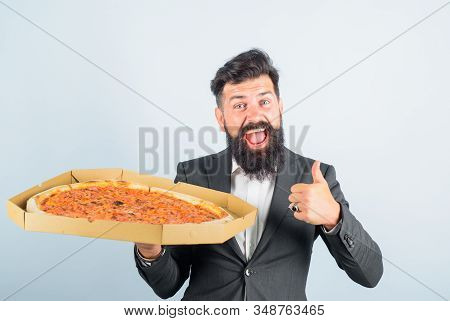 Pizza Delivery Concept. Businessman Holds Pizza Shows Thumb Up. Food, Business Lunch. Businessman Ho