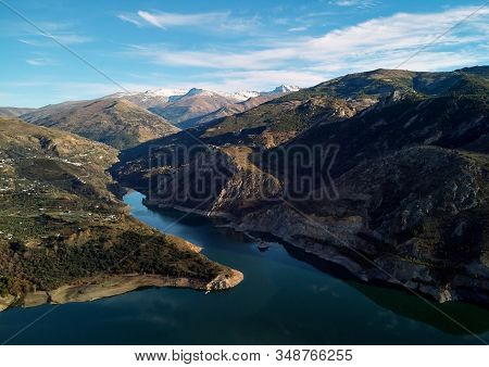 Aerial Photography Rocky Snow-capped Sierra Nevada Mountains Embalse De Canales Reservoir In Guejar