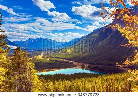 Magnificent landscape in the valley of the Kananaskis river. The azure icy water in the mountain valley of Peter Lougheed Provincial Park. The concept of active, ecological and photo tourism