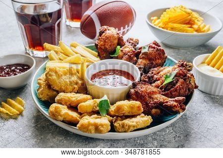 Table Fof Tasty Snacks For Beer Prepared For Watching Sports On Tv. Chicken. Chicken Wings, Chicken